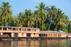 Landscape with reflection houseboat in kerala backwaters Stock Photography