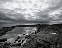 Landscape and reflections. In black and white. Impressive sky of the lofoten islands (norway Stock Image