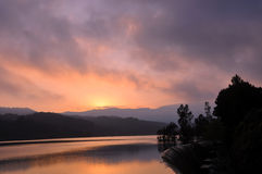Landscape of reservoir and mountains at twilight sunset. Royalty Free Stock Photos