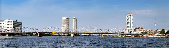 Landscape of River in Bangkok city, Thailand. Panoramic view of modern Bangkok with skyscrapers and bridge, Chao Phraya River, Thailand Royalty Free Stock Photos