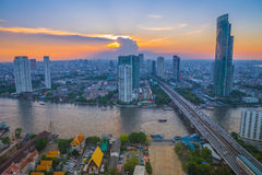Landscape of river in Bangkok cityscape with sunset royalty free stock images