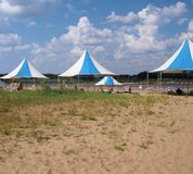 River beach with awnings in summer. Landscape of a river beach with awnings in summer Royalty Free Stock Photography