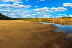 Landscape of river and beach with cloudly sky Stock Image