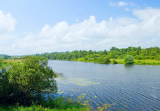 Landscape with river and blue sky Stock Photography