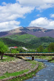 Landscape of a river with bridge among Carpathians mountains Royalty Free Stock Photography
