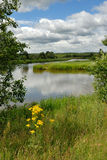 Landscape with the river and clouds. Royalty Free Stock Photos
