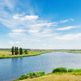 Landscape with river and clouds in blue sky Royalty Free Stock Image