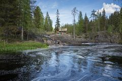 Landscape with a river in the forest. SORTAVALA, RUSSIA - JUNE 10, 2017: Landscape with a river in the forest of Karelia Royalty Free Stock Image