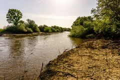Landscape with the river and green vegetation of trees and plant. S on the river banks. Beautiful clear blue sky and the water of the river. River Sorraia in stock images