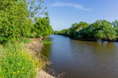 Landscape with the river and green vegetation of trees and plant. S on the river banks. Beautiful clear blue sky and the water of the river. River Sorraia in stock photo