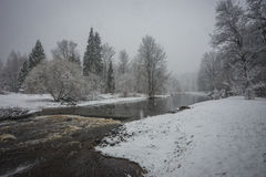Landscape with a river and its banks covered with fluffy snow Royalty Free Stock Photography