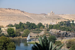Landscape of River Nile at Aswan. The ancient city of Philae looms over the River Nile Royalty Free Stock Images