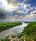 Landscape with river and rain on horizon Royalty Free Stock Photography