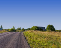 Landscape with road and blue sky Stock Photos