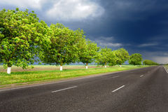 Landscape with road and dark sky Royalty Free Stock Photos