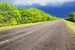 Landscape with road and dark sky Royalty Free Stock Image