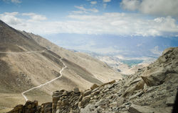 Landscape with road down mountain royalty free stock image