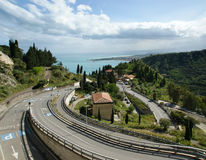 Landscape with a road leading to the sea, Sicily Royalty Free Stock Photo