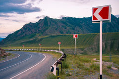 Landscape. The road in the mountains turns to the left. Ahead of breakage. Stock Image
