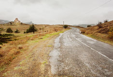 Landscape with road after rain, and ancient church on the background, Georgia country Royalty Free Stock Image