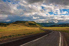 Road mountains steppe sky Royalty Free Stock Image