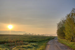 Landscape with road at sunrise Stock Photography