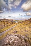 Landscape with a road to the Glanmore lake. Freshwater lake in the southwest of Ireland. It is located on the Beara Peninsula in County Kerry royalty free stock photos