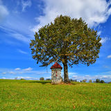 Landscape with roadside shrine. Poland. Royalty Free Stock Photos