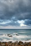 Landscape of rock coast and beautiful cloud Stock Photos
