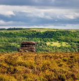 Landscape of a rock formation in three layers of grass, trees an royalty free stock images
