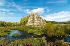 Landscape with rock by the river in autumn, Stock Photos