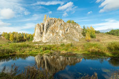 Landscape with rock by the river in autumn, Stock Photo