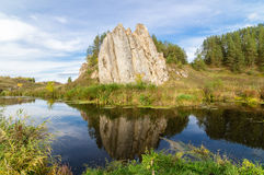 Landscape with rock by the river in autumn, Stock Photography