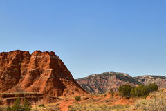 Landscape with rocks in Palo Duro Canyon, USA. Landscape with rocks against clear blue sky in Palo Duro Canyon, Texas, USA Royalty Free Stock Photography
