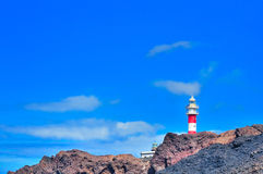 Landscape with rocks, sky and beacon. Stock Images