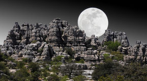 Landscape of rocky mountains with moonlight. El Torcal near Antequera, in Spain, is a natural park where there are bizarre rock formations stock photo