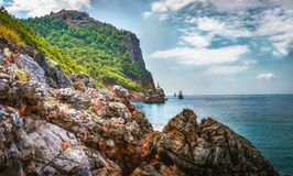 Landscape of rocky mountains and sea on coastline. Bay with ships in tropical Mediterranean Sea. Turkish nature Stock Photography