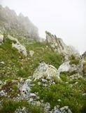 Misty rocky mountains Stock Image