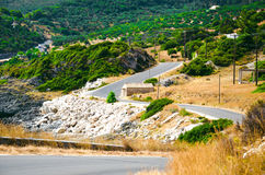 Landscape of the rocky road. With a small house at the hillside Royalty Free Stock Photos