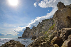 Landscape on the rocky shore of the sea and high of cliffs, Crimea, Novy Svet stock photo