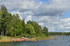 Landscape with rocky shores. Of pink granite. Finland Stock Images