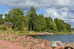 Landscape with rocky shores. Of pink granite. Finland Stock Photo