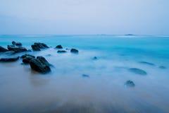 Landscape rocky tropical night beach. Stock Photo