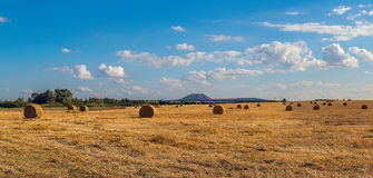 Landscape with rolls of hay and mountain Royalty Free Stock Photos