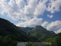 Landscape Romania hills water lake clouds Royalty Free Stock Photography
