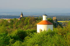 Landscape with rotunda and castle ruin. Early spring landscape with rotunda on Ovci vrch and castle ruin of Swamberg (Krasikov Royalty Free Stock Images