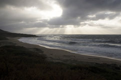 Landscape of rough sea with cloudy sky by storm and burst of lig. Ht as background Stock Photos