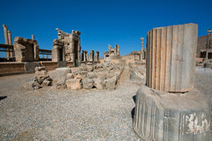 Landscape with ruined city and stone columns in Persepolis, Iran. Royalty Free Stock Images