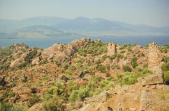 Landscape with ruins of Byzantine town over the lake, nature reserve of Turkey with olive trees and mountains around Royalty Free Stock Photo