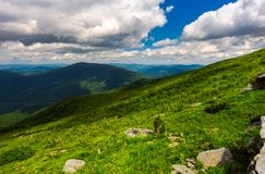 Landscape of Runa mountain with boulders on hills. Gorgeous landscape of amazing Carpathian mountains on a summer day with cloudy sky Stock Photo